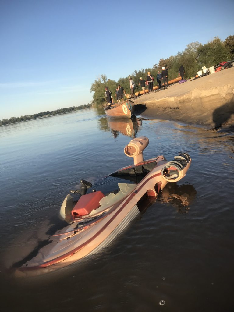 """The """"wreck of the Anthropocene future."""" A toy Landspeeder washed up on a beach on the Lower Mississippi (Joe Underhill Field Note)"""