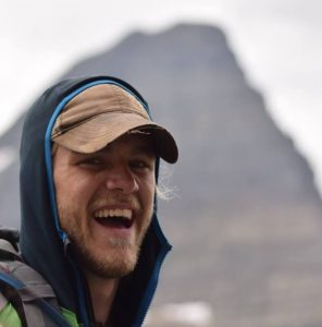 Baird Link smiling in front of a mountain