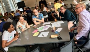 Innovation Coach Amanda Vetsch visits with Partner Congregations Redeemer Lutheran Church ELCA - North Minneapolis and Bethany Lutheran Church in the Seward Neighborhood. Everyone sat around the table and discussed.