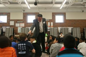 Dennis Donovan working with school children