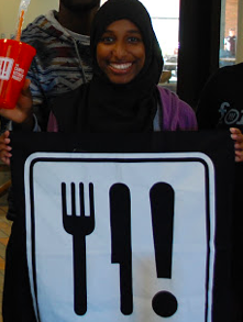 Student holding CK sign