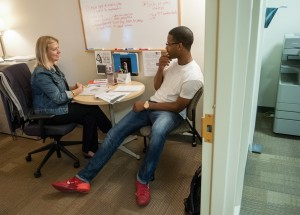 Student meeting with career coach in Strommen Center for Meaningful Work.