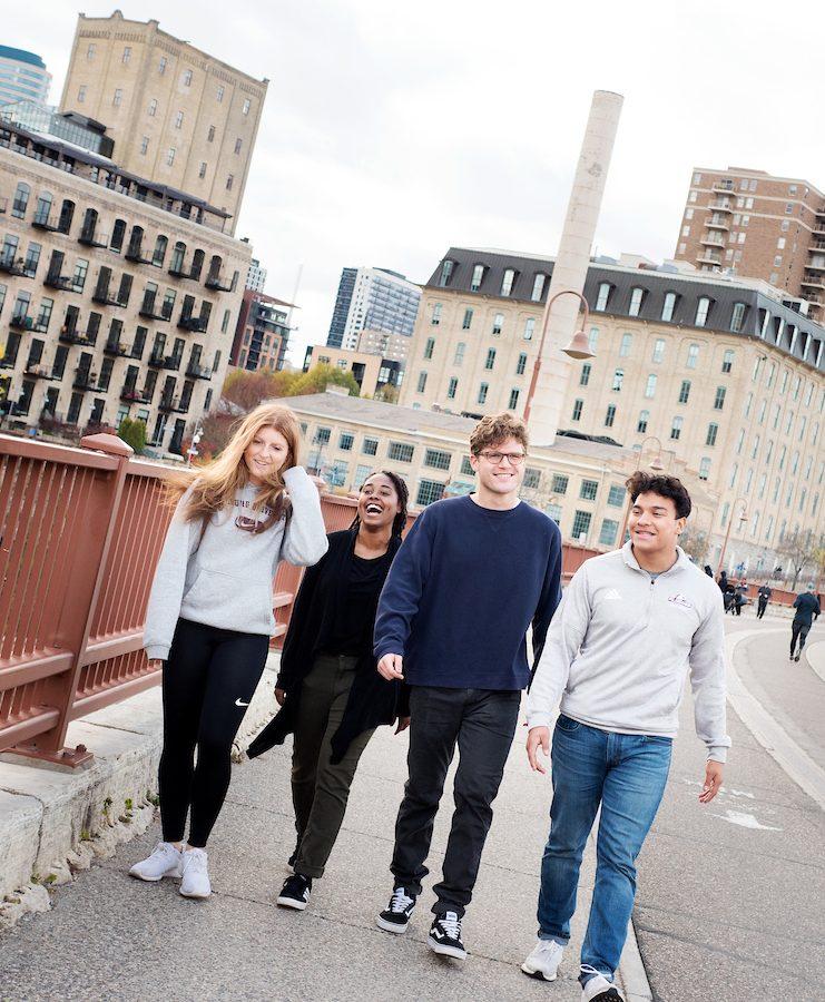 Augsburg Students on the Stone Arch Bridge