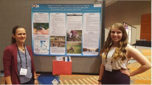 Photo of Holly Kundel with faculty mentor, Emily Schilling, and research poster