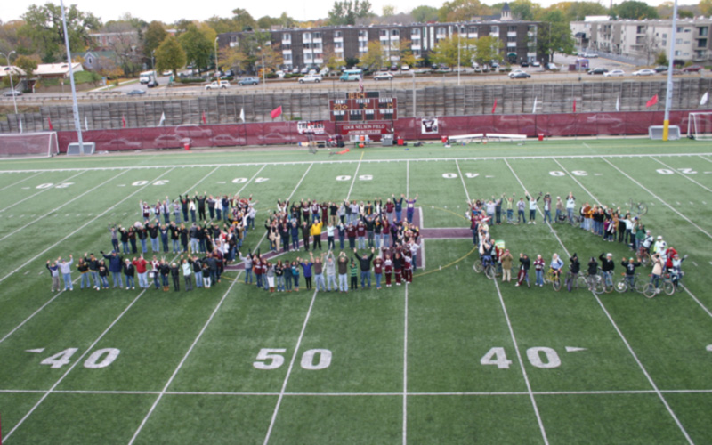 Augsburg community members form the number 350 on the football field