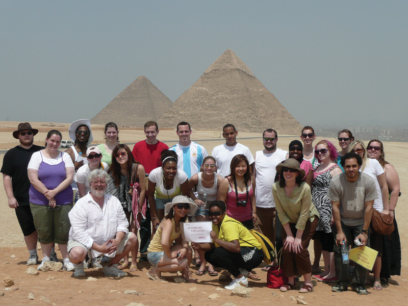 Students stand in front of pyramids