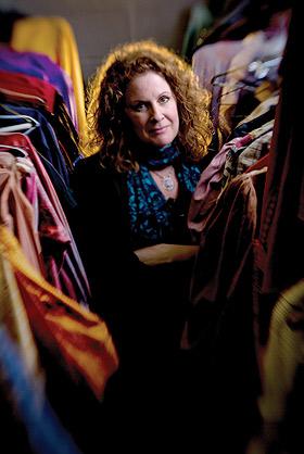 Darcey Engen stands near costumes