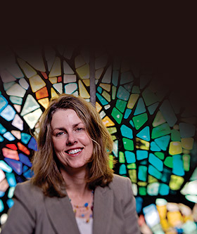 Lori Brandt Hale in front of stained glass window