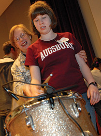 Roberta Kagin works with an Augsburg student