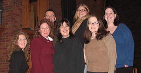 Dorian Chalmers, Darcey Engen '88, Janet Paone '83, Linda Twiss. Back row, L to R: Doug Flateau, Deb Pearson '83, Katie Koch '06.