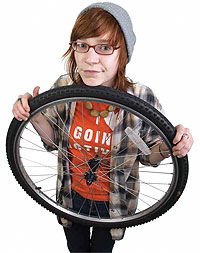 Student holding a bicycle tire