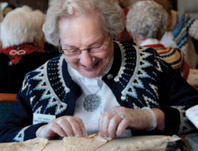 picture of woman making lefse