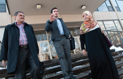 Ibrahim Al-Hajiby '14, center, leaves Christensen Center with Nobel Peace Prize Laureate Tawakkol Karman, right, and Karman's husband.
