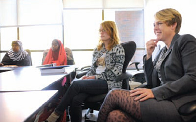 Aasen, far right, meets with Augsburg students